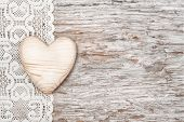 Wooden Heart On Lacy Cloth And Old Wood