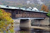 foto of covered bridge  - Covered wooden bridge in the town of Lovech in Bulgaria over the Osam river - JPG