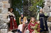 Girls In The Scandinavian Historical Suits On A Ancient Stone Wall Background poster