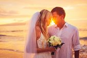 Bride and Groom, Enjoying Amazing Sunset on a Beautiful Tropical Beach, Romantic Married Couple Kiss