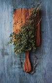 Dried wild oregano on a kitchen board