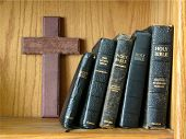 stock photo of glorify  - wooden cross with bibles - JPG