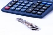 British Coins And Calculator Front View Dof