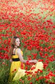 Smiling Girl With Yellow Scarf In Poppy Field