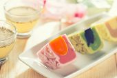 stock photo of mid autumn  - Colorful snow skin mooncakes on white plate with teacup - JPG