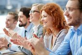 pic of applause  - Photo of happy business people applauding at conference - JPG