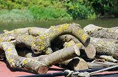 image of avon  - Firewood on top of narrowboat alongside the River Avon Stratford - JPG