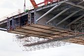 foto of scaffold  - steel bridge construction with scaffolding and welding - JPG