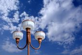 Lamp post in fluffy sky poster