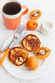 stock photo of loquat  - Cottage cheese pancakes and fresh loquat for breakfast
