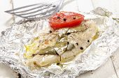 stock photo of pangasius  - baked pangasius with pepper and tomato in tin foil - JPG