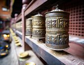 stock photo of piety  - Prayer wheels in a monastery in Kathmandu - JPG