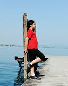 image of dock a pond  - Girl on a sea dock - JPG