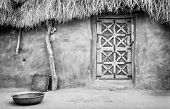 stock photo of mud-hut  - Exterior of a village hut in the Great Thar Desert India in black and white - JPG