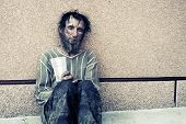 foto of beggar  - Homeless man in depression  - JPG