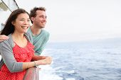 Постер, плакат: Cruise ship couple romantic on boat looking at view in romance Happy lovers woman and man travelin
