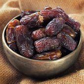 pic of dry fruit  - Pile of fresh dried date fruits in metal bowl - JPG