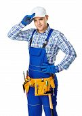 stock photo of locksmith  - Portrait of young male construction worker with tool belt touching his white cap isolated on white background - JPG