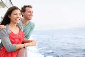 stock photo of passenger ship  - Cruise ship couple romantic on boat looking at view in romance - JPG