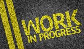 image of precaution  - Work In Progress written on the road - JPG