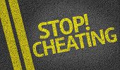 foto of cheating  - Stop Cheating written on the road - JPG