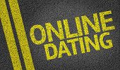 stock photo of long distance relationship  - Online Dating written on the road - JPG