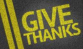 stock photo of give thanks  - Give Thanks written on the road - JPG