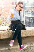 picture of underage  - Young and beauty female have relaxing time with beer and communication on mobile phoneselective focus - JPG