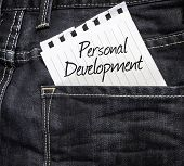 stock photo of self assessment  - Personal Development written on a peace of paper on a jeans background - JPG