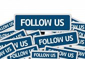 Follow Us written on multiple blue road sign poster