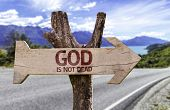 image of grateful dead  - God Is Not Dead wooden sign with a street background  - JPG