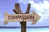 foto of compassion  - Compassion sign with a beach on background  - JPG