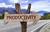 stock photo of maxim  - Productivity wooden sign with a street background  - JPG