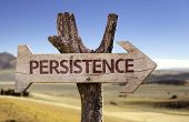 stock photo of persistence  - Persistence wooden sign with a desert background - JPG