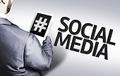 stock photo of hashtag  - Business man with the text Social Media in a concept image - JPG