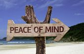stock photo of peace  - Peace of Mind wooden sign with a beach on background - JPG