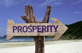 foto of prosperity sign  - Prosperity wooden sign with a beach on background - JPG