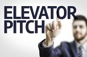 pic of elevators  - Business man pointing to transparent board with text - JPG