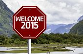 foto of reveillon  - Welcome 2015 written on red road sign with landscape background - JPG