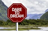 picture of daring  - Dare to Dream written on red road sign with landscape background - JPG