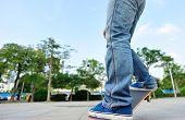 image of skateboarding  - young skateboarder legs skateboarding at modern city - JPG