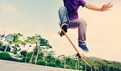 pic of skateboarding  - young asian woman skateboarder skateboarding at city - JPG