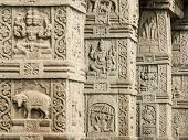 stock photo of shiva  - Ornate pillars supporting the entrance of an old Shiva Temple in Nanjangud - JPG