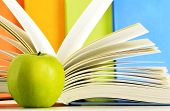 picture of hardcover book  - Composition with hardcover books and apple in the library - JPG