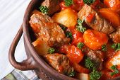 picture of stew pot  - stew in tomato sauce with vegetables in a pot macro - JPG