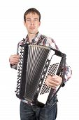 stock photo of accordion  - Man playing at an accordion isolated over white - JPG