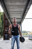 pic of hunk  - Handsome Hunk Man Lifting Weights Outdoor - JPG