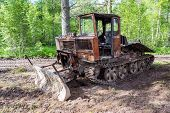 stock photo of afforestation  - Old skidder at the forest in summertime - JPG