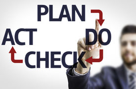 stock photo of plan-do-check-act  - Business man pointing to transparent board with text - JPG
