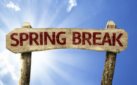 stock photo of post-teen  - Spring Break wooden sign on a summer day - JPG